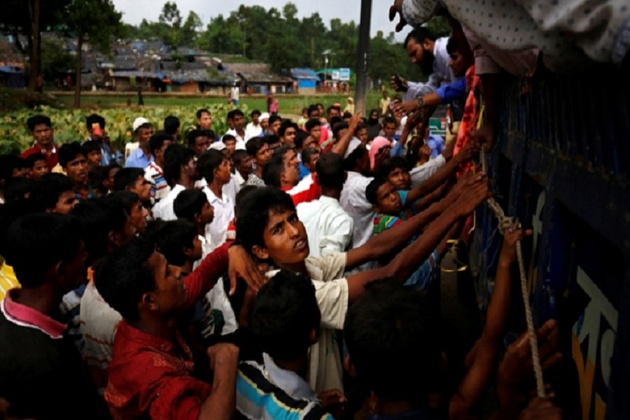 Rohingya refugees gather as they expect relief supplies in Kutupalang near Cox's Bazar. Reuters