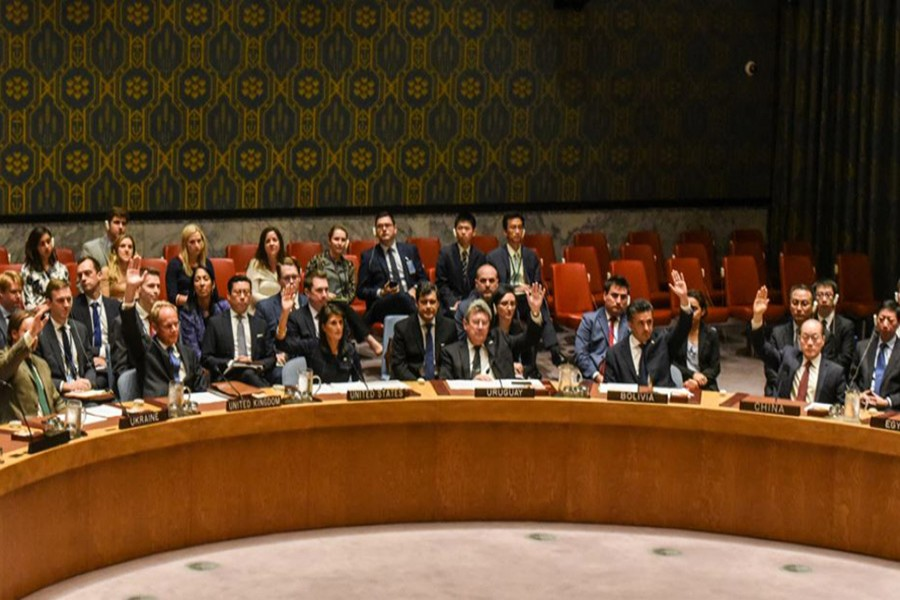 Ambassadors to the UN vote during a United Nations Security Council meeting on North Korea in New York City on Monday.