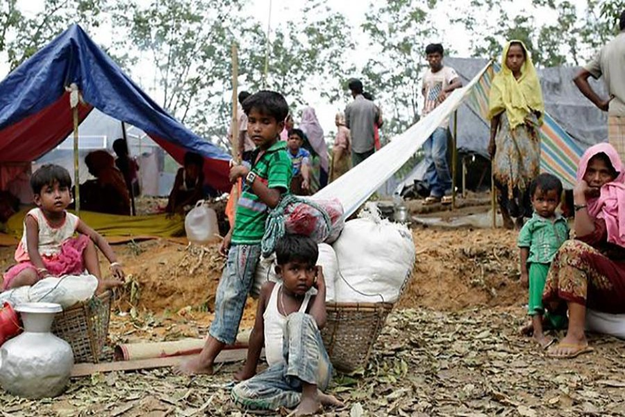 Rohingya family sit in front of their makeshift shelters in a camp in Ukhiya, Cox's Bazar, Bangladesh on Monday last. Photo courtesy: AAP