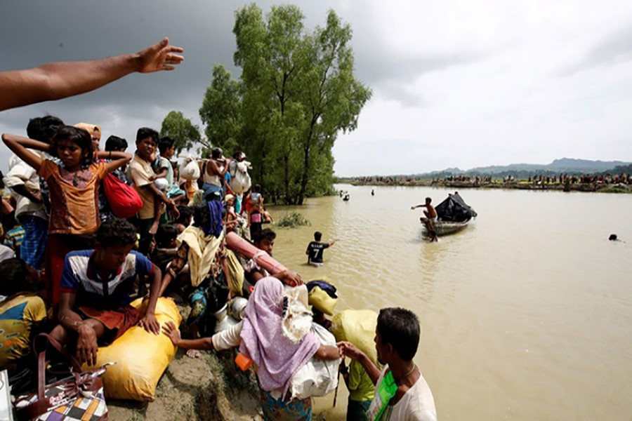 Rohingya refugees wait for boat to cross a canal after crossing the border through the Naf river in Teknaf, Bangladesh. - Reuters file photo