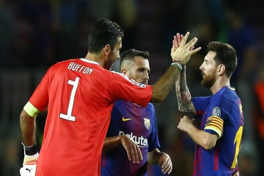 Barcelona's Lionel Messi shakes hands with Juventus goalkeeper Gianluigi Buffon at the end of a group D Champions League soccer match between FC Barcelona and Juventus at the Camp Nou stadium at Barcelona in Spain on Tuesday.— AP