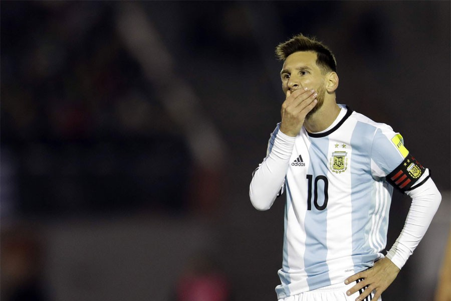 Argentina's Lionel Messi gestures during a 2018 World Cup qualifying soccer match against Uruguay in Montevideo. | AP