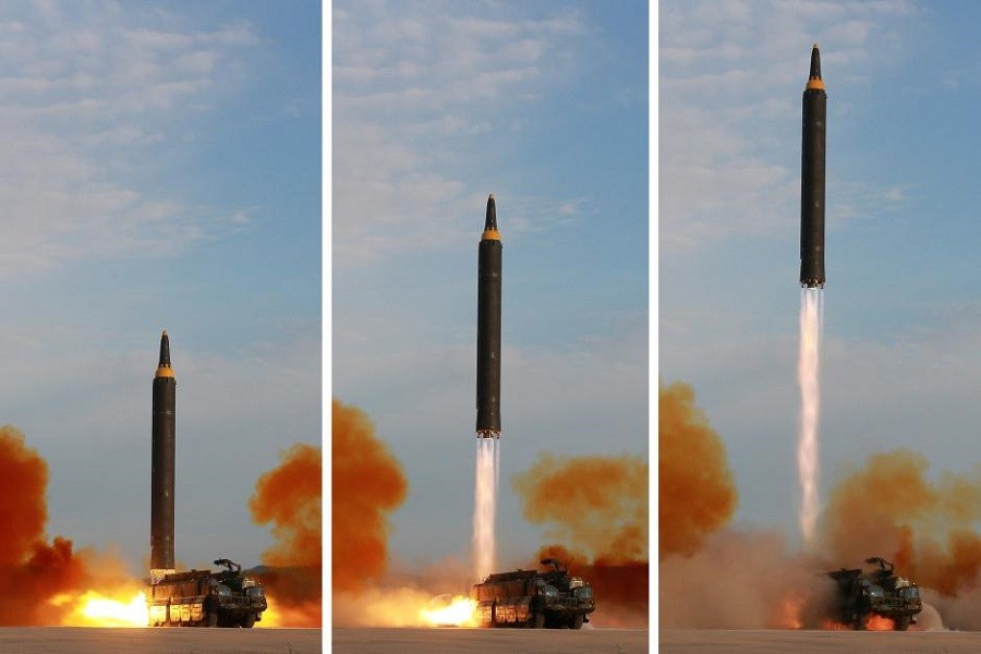 North Korean leader Kim Jong Un (not pictured) guides the launch of a Hwasong-12 missile in this undated combination photo released by North Korea's Korean Central News Agency (KCNA) on September 16, 2017. KCNA via Reuters