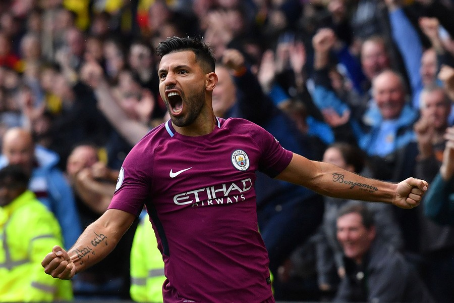 Manchester City's Argentinian striker Sergio Aguero celebrates scoring his third and the team's fifth goal against Watford on Saturday.— Reuters