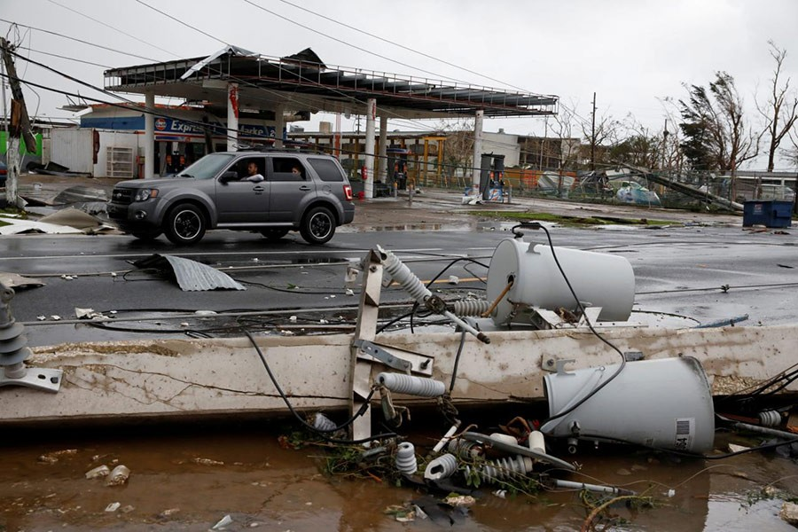Damaged electrical installations are seen after the area was hit by Hurricane Maria en Guayama, Puerto Rico on Wednesday. - Reuters photo