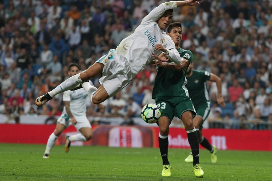 Real Madrid's Cristiano Ronaldo in action with Betis' Aissa Mandi during Wednesday's clash. - Reuters photo