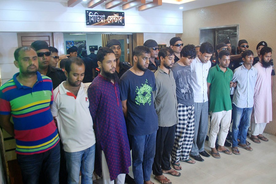 The RAB team also seized laptops, mobile phones, and documents from their possession. - Focus Bangla photo