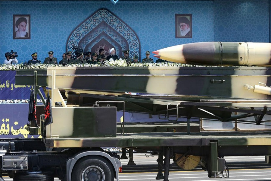 Missiles are displayed as Iranian President Hassan Rouhani attends an armed forces parade in Tehran, Iran on Friday. - Reuters photo