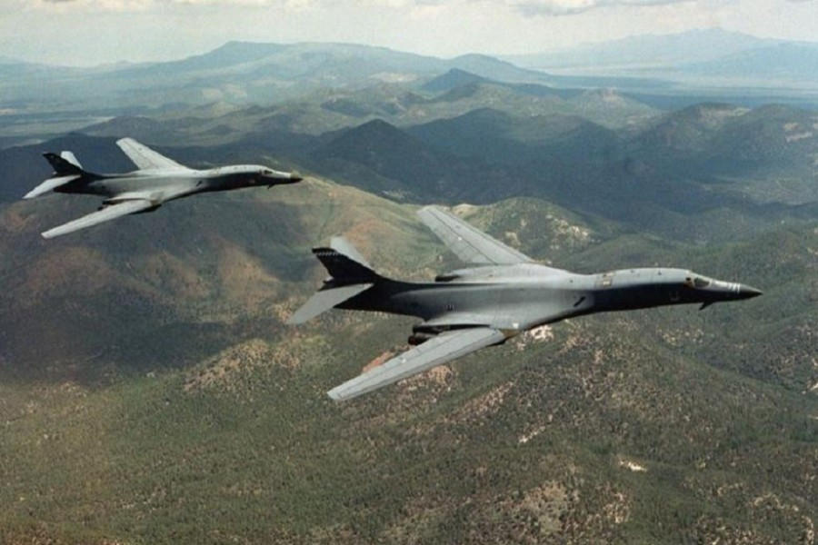 A pair of B-1B Lancer bombers soar over Wyoming in an undated file photo. US Air Force/Handout via Reuters
