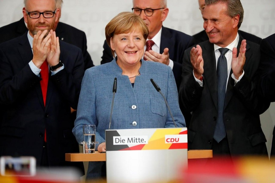 Christian Democratic Union CDU party leader and German Chancellor Angela Merkel reacts after winning the German general election (Bundestagswahl) in Berlin, Germany, September 24, 2017. Reuters