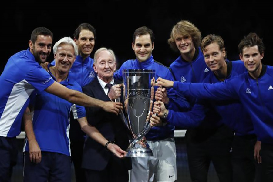 Team Europe together with tennis legend Australian Rod Laver hold the trophy after defeating team World. - Reuters photo