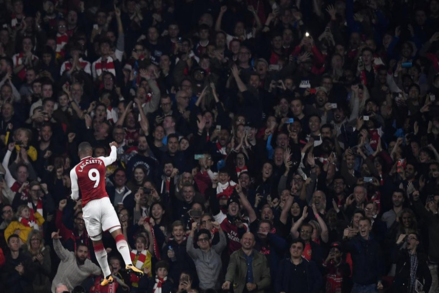 Arsenal's Alexandre Lacazette celebrates scoring their first goal during Monday's clash against West Bromwich. - Reuters photo