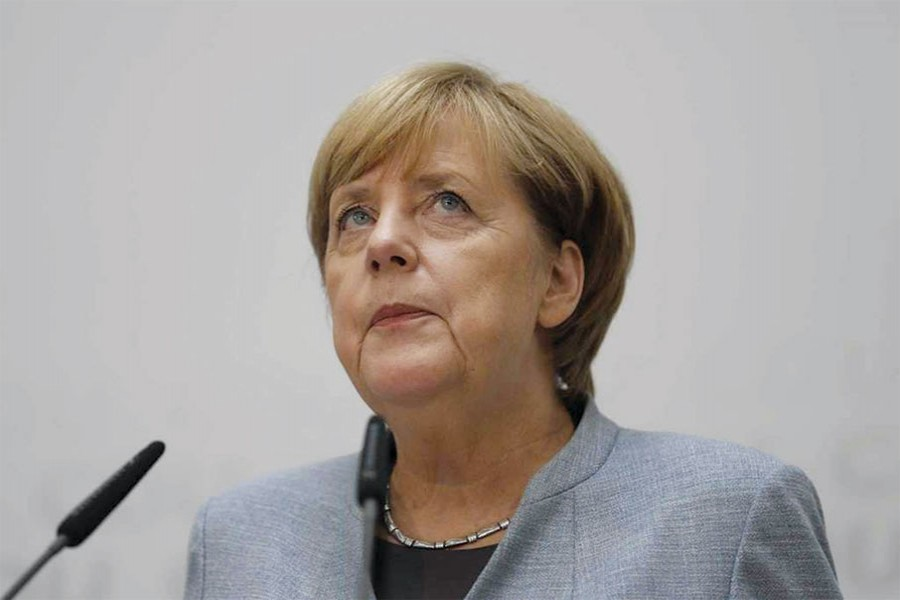 GERMAN CHANCELLOR ANGELA MERKEL PONDERS DURING A PRESS CONFERENCE AFTER A BOARD MEETING OF THE CHRISTIAN DEMOCRATIC UNION CDU IN BERLIN, GERMANY, MONDAY, SEPT. 25, 2017.