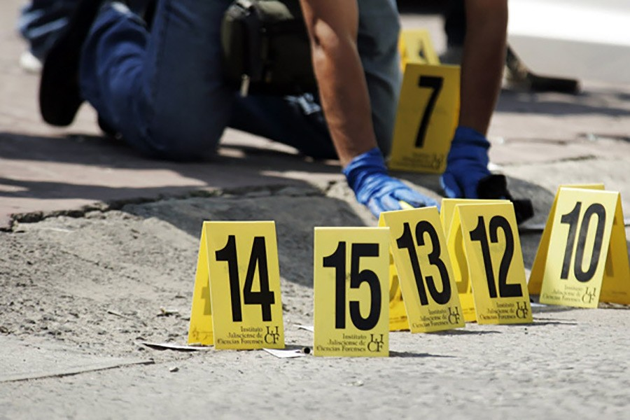 A police officer places police markers next to bullet cases at a crime scene in Mexico. Reuters file photo used for representation.