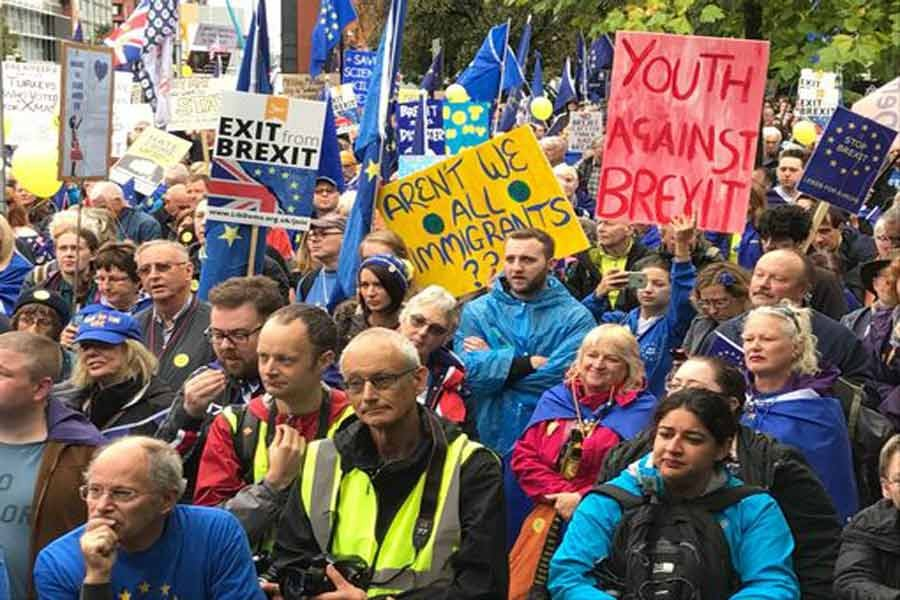 Ant-Brexit activists protest Tory austerity policies