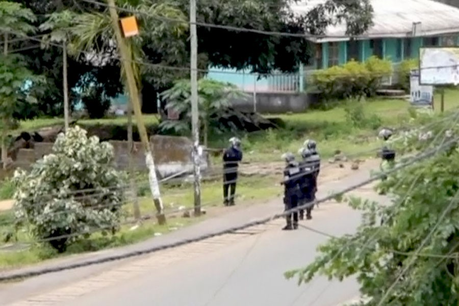 A still image taken from a video shows riot police patrol the English-speaking city of Buea, Cameroon October 1, 2017. (REUTERS TV)