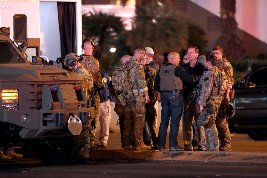 FBI agents confer in front of the Tropicana hotel-casino after a mass shooting during a music festival on the Las Vegas Strip in Las Vegas, Nevada on Sunday. - Reuters
