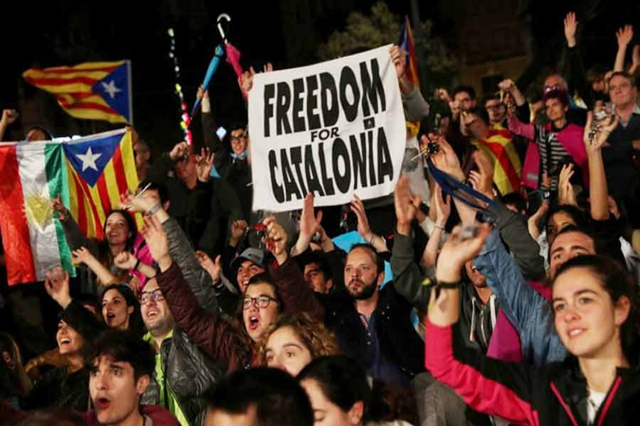 People react as they gather at Plaza Catalunya after voting ended for the banned independence referendum at Barcelona in Spain on Sunday.— Reuters