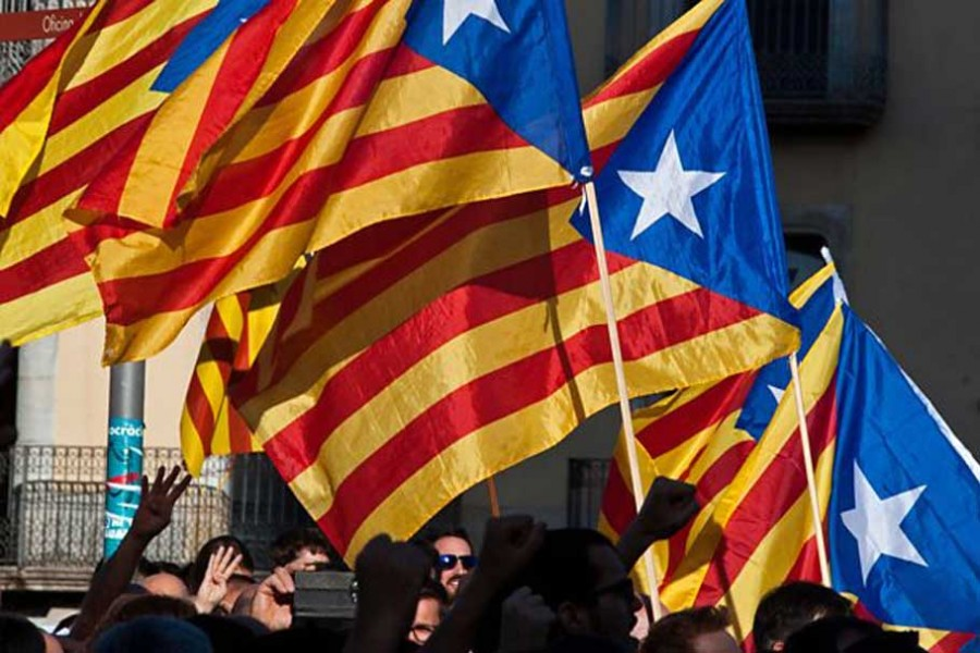 Pro-independence Catalans defy King Felipe VI's warning