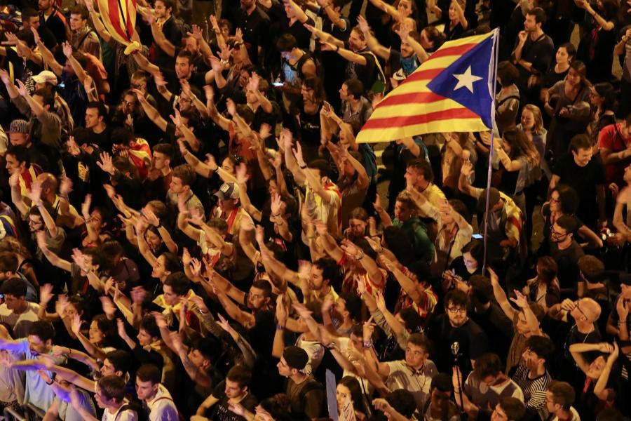 Catalonians raise arms and shout during a demonstration two days after the October 1 banned independence referendum. - Reuters photo
