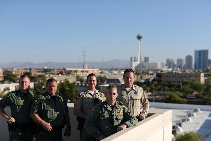 Las Vegas police officers who were part of the MACTAC (Multi-Assault Counter-Terrorism Action Capabilities) team that went into the Mandalay Bay Resort and Casino during the shooting pose for a photo in Las Vegas. Reuters