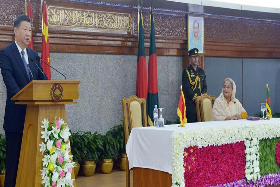 Chinese President Xi Jingping speaks at a meeting with Bangladesh Prime Minister Sheikh Hasina during the former's Dhaka visit.