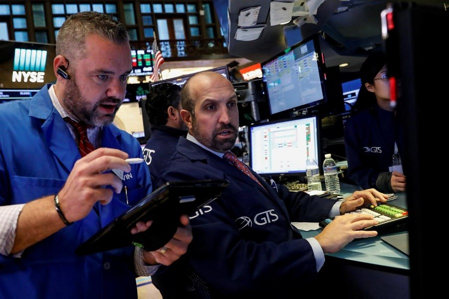 Traders work on the floor of the New York Stock Exchange (NYSE) in New York, US, October 3, 2017. Reuters