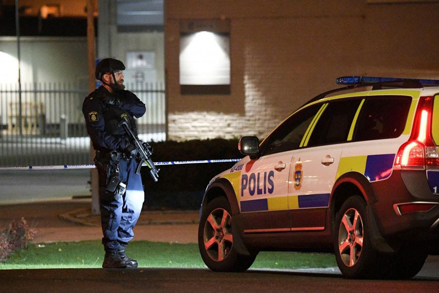 Police officer guards outside a cordoned area surrounding the police station in Helsingborg, Sweden, after a powerful explosion at the main entrance. (Reuters)
