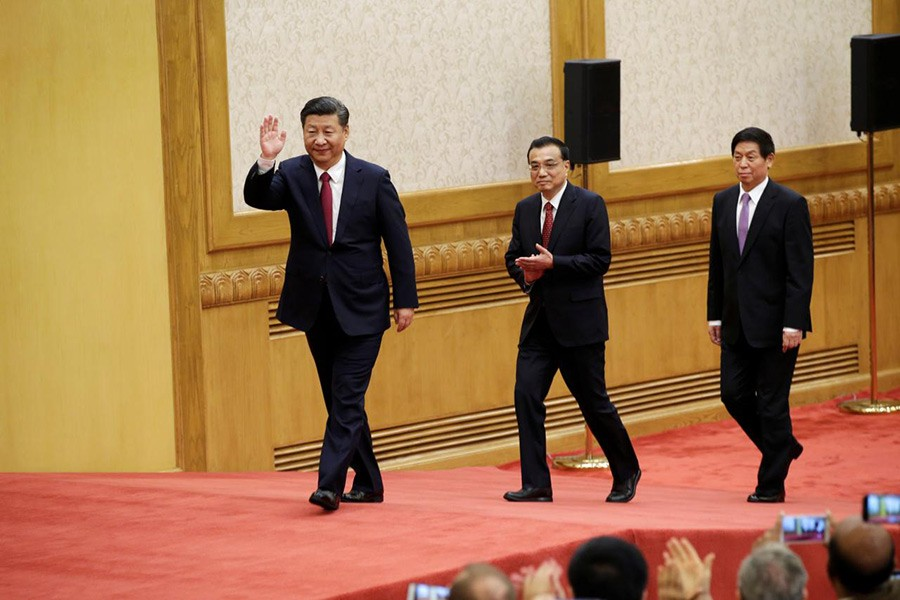 China's new Politburo Standing Committee members (L-R) Xi Jinping, Li Keqiang, and Li Zhanshu, arrive to meet with the press in Beijing on Wednesday. - Reuters photo