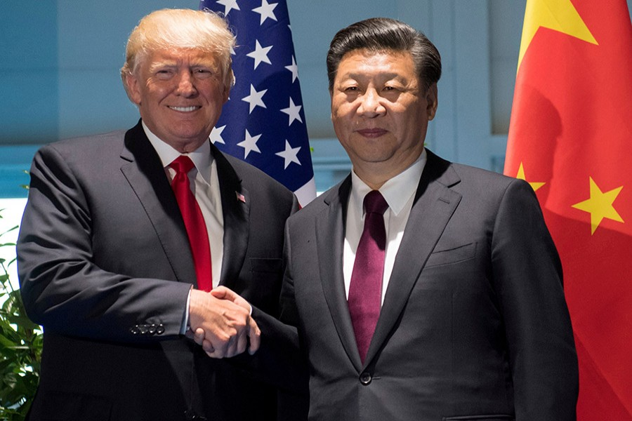 Trump is expected to meet Xi when he visits China next month. - Reuters file photo