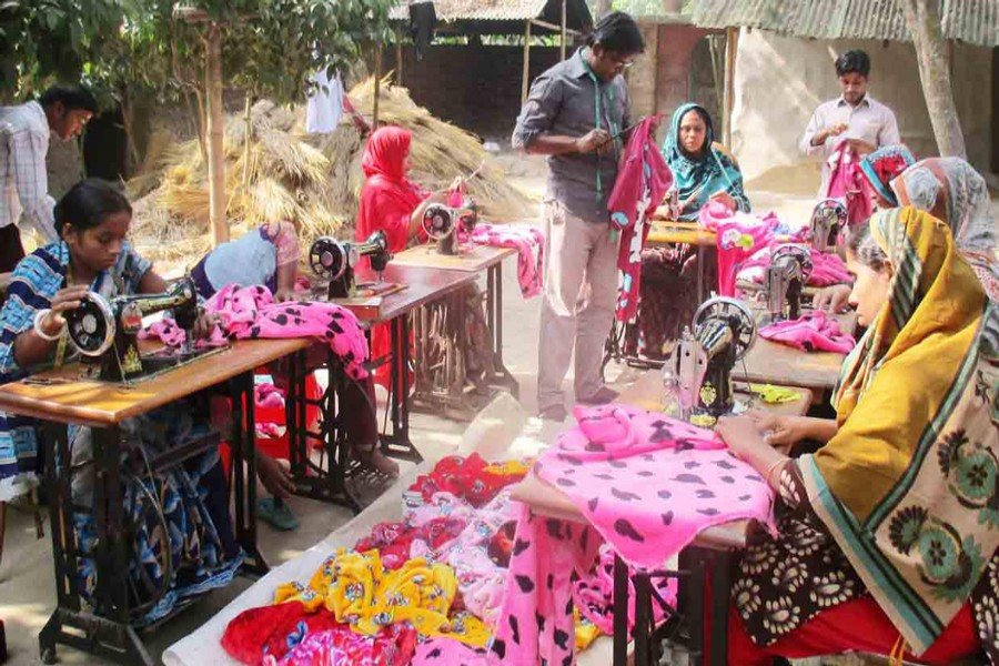 A group of female tailors are busy making clothes at Dhupchanchia upazila in Bogra on Thursday. — FE Photo