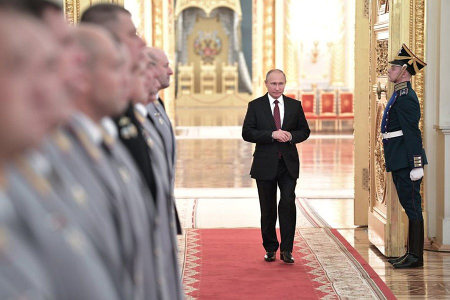 Russian President Vladimir Putin walks in a hall during a meeting at Kremlin in Moscow on Thursday. -AP Photo