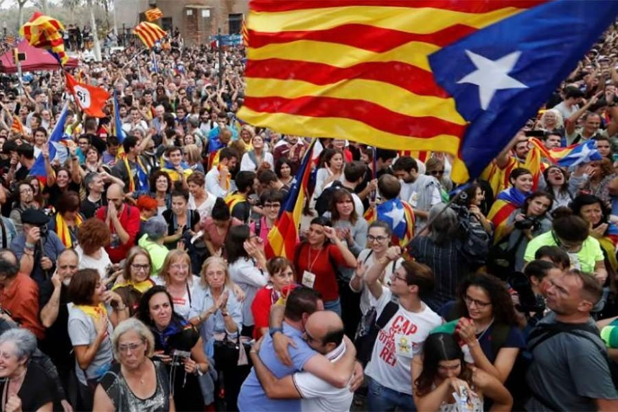 People celebrate after the Catalan regional parliament passes the vote of independence from Spain in Barcelona, Spain on Friday. Photo: Reuters