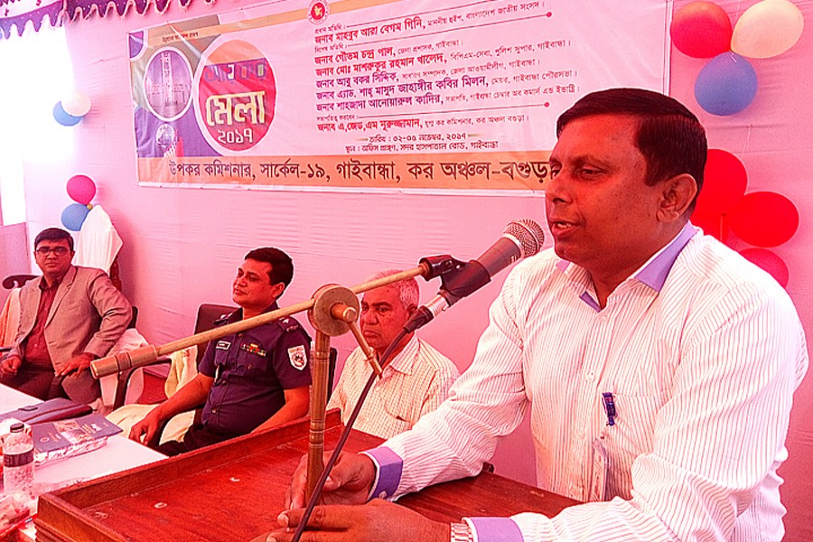 DC Gautam Chandra Pal addressing the inaugural session of the four-day Income Tax Fair-2017 arranged by the Deputy Commissioner of Taxes, Circle 19, Gaibandha, on its office premises in the town on Thursday. — FE Photo