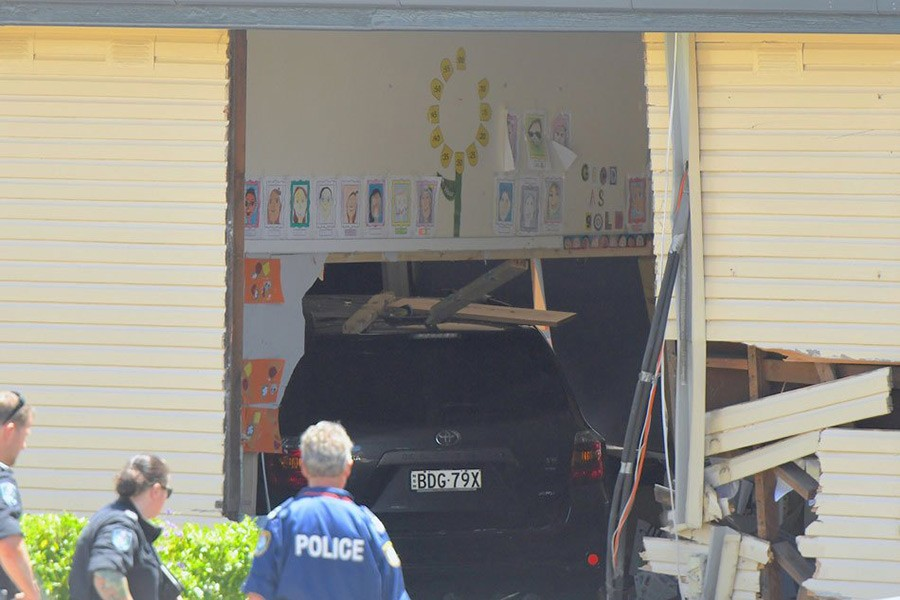New South Wales emergency services personnel and police look at a vehicle that crashed into a primary school classroom in the Sydney suburb of Greenacre in Australia on Tuesday.