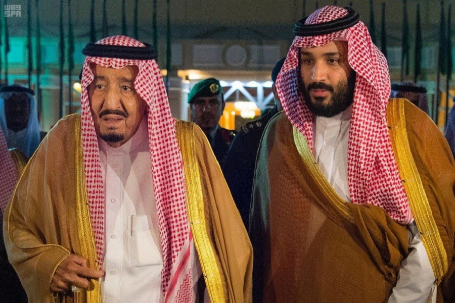 Saudi Arabia's King Salman bin Abdulaziz Al Saud walks with his son and Crown Prince Mohammed bin Salman, before King Salman leaves for Medina, in Riyadh, Saudi Arabia, November 8, 2017. Saudi Press Agency/Handout via Reuters Attention Editors