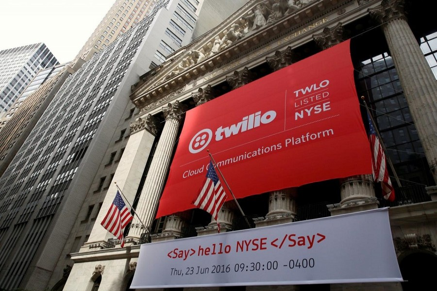 A banner for communications software provider Twilio Inc hangs on the facade of the New York Stock Exchange (NYSE) to celebrate the company's IPO in New York City, US, June 23, 2016. Reuters