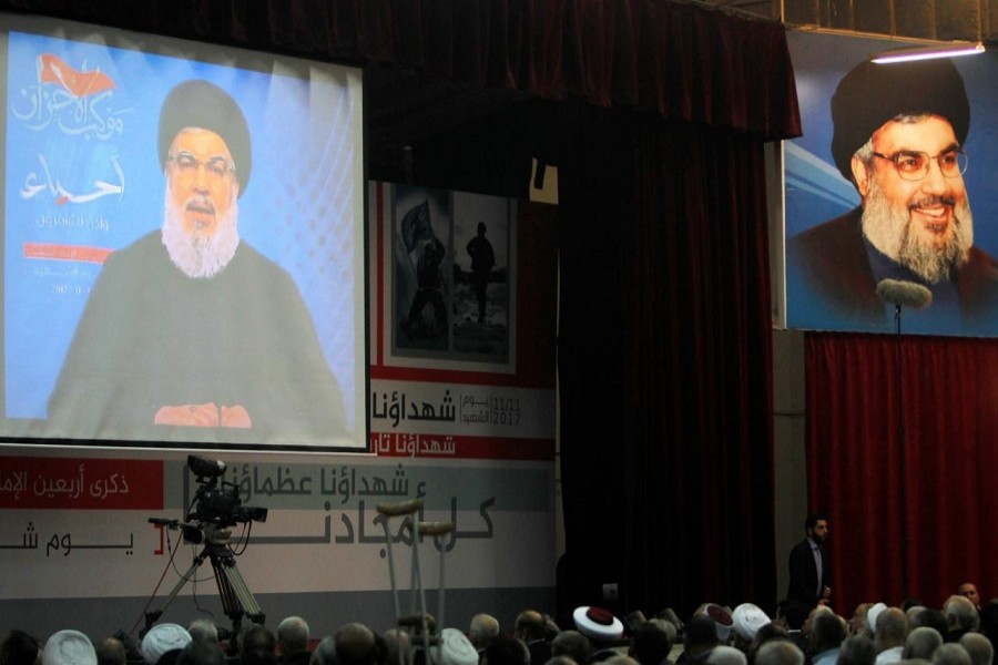Lebanon's Hezbollah leader Sayyed Hassan Nasrallah is seen on a video screen as he addresses his supporters in Beirut, Lebanon November 10, 2017. Reuters