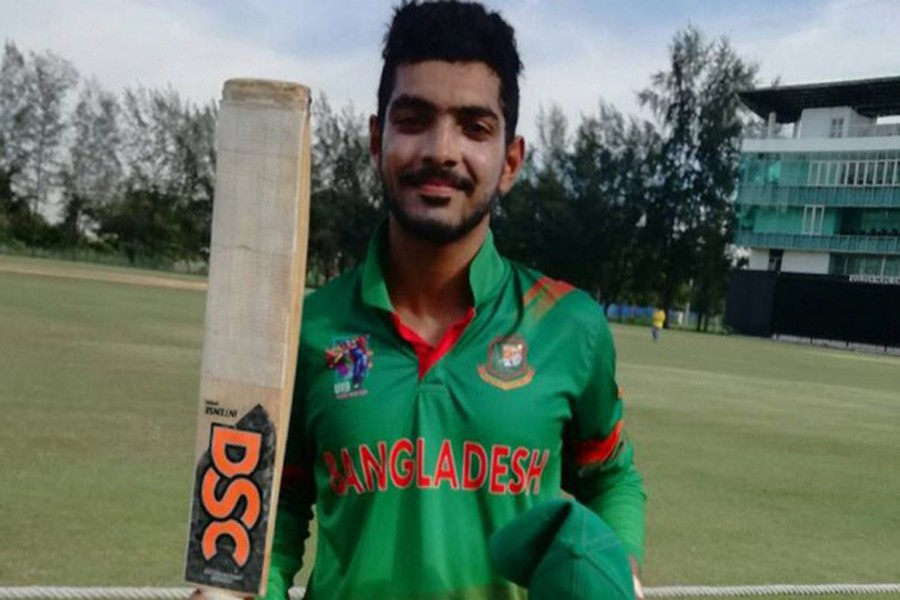 Towhid Hridoy poses with his bat after scoring century in the match between Bangladesh and Malaysia during the ACC Youth Asia Cup Cricket 2017 at Bayuemas Oval in Kuala Lumpur on Monday. — bdnews24.com