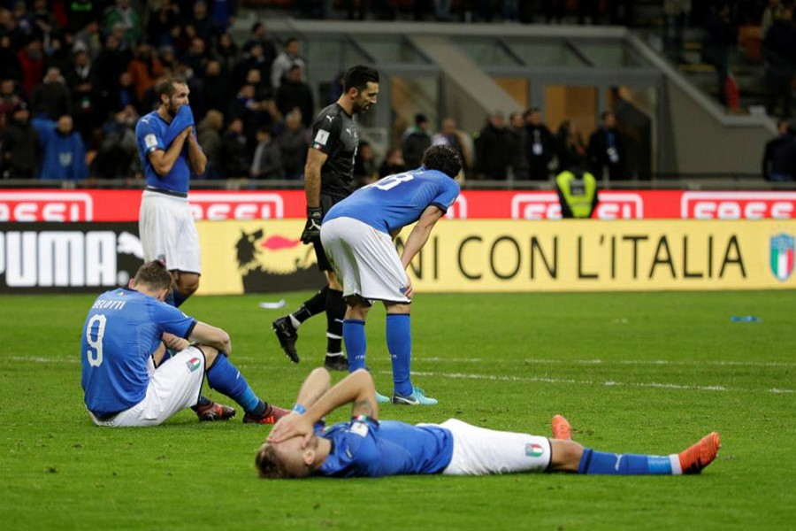 Italy players cut dejected figures after the match as they failed to qualify for the World Cup for the first time in 60 years. - Reuters photo
