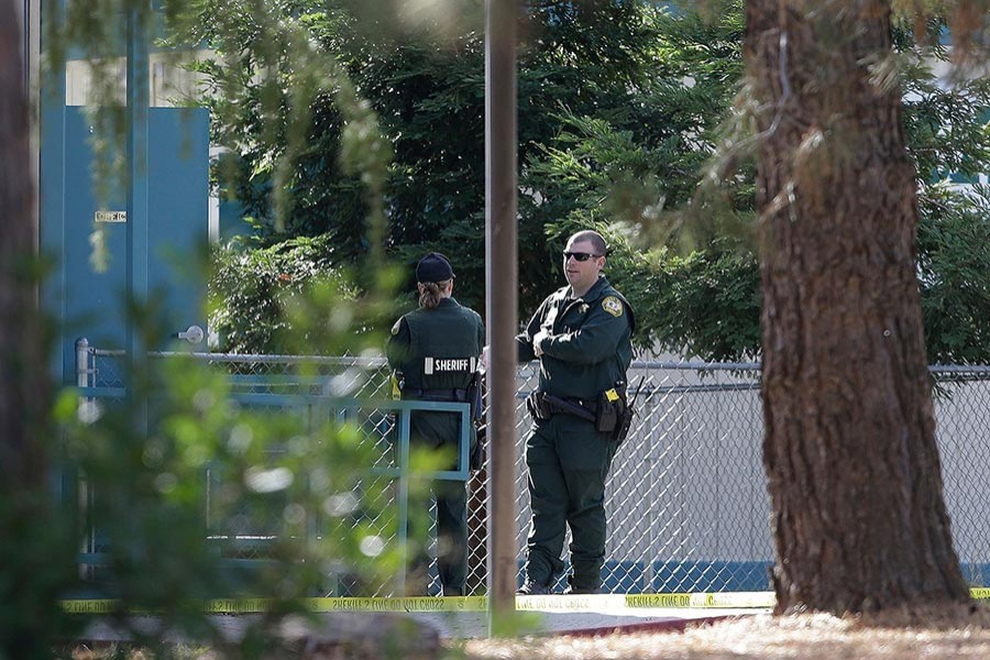 Law enforcement officers are seen at an elementary school in the community of Rancho Tehama Reserve, where a gunman opened fire on Tuesday in California. - AP photo