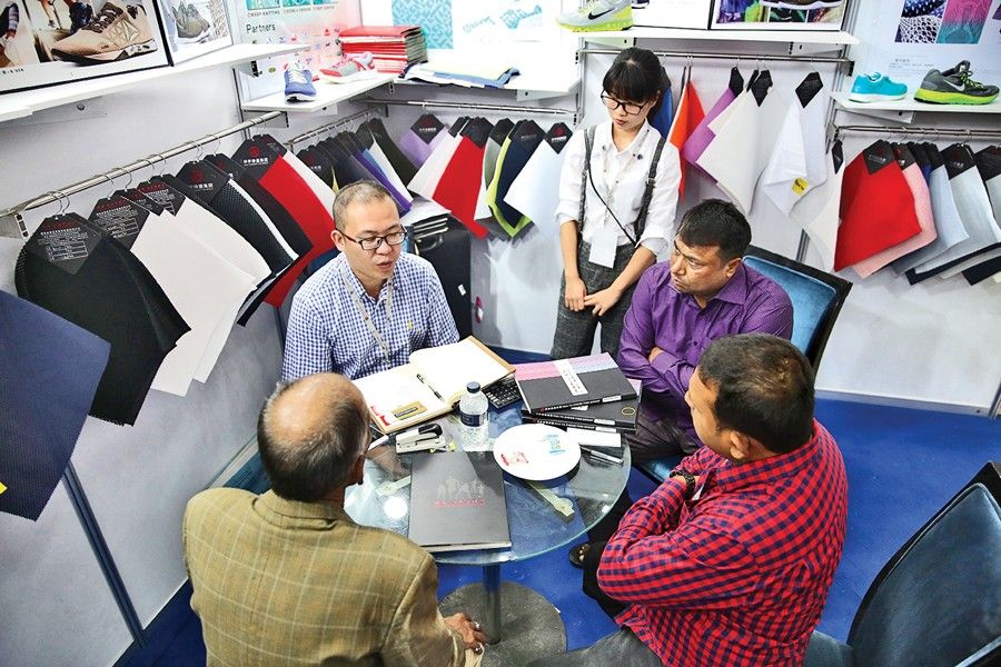 Company officials are negotiating with a buyer representative at a stall of the Bangladesh Leather Footwear & Leathergoods International Sourcing Show 2017, which began in Dhaka Thursday.   — FE Photo