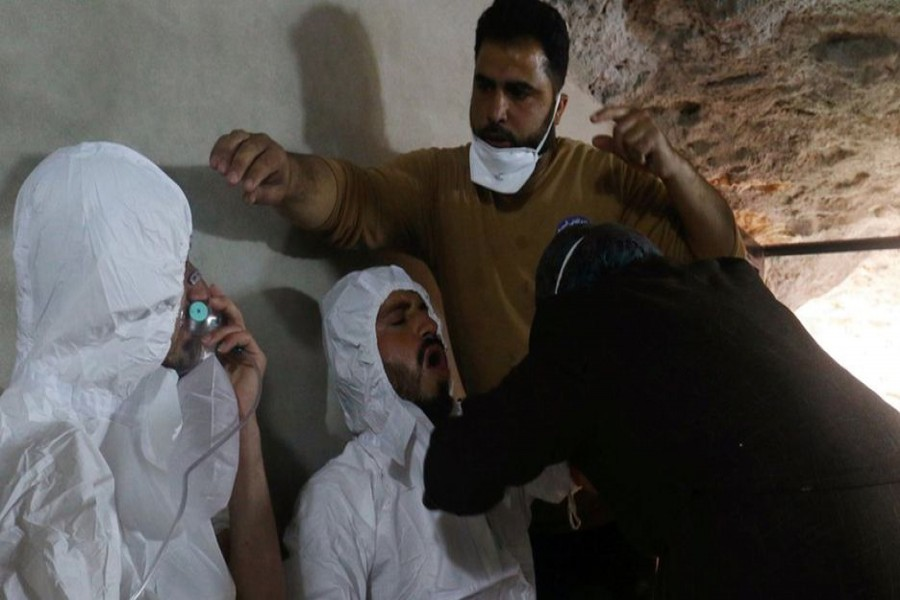 Some victims taking treatment at a hospital. A nerve gas attack on the town of Khan Sheikhoun in April killed more than 80 people. — Reuters file photo