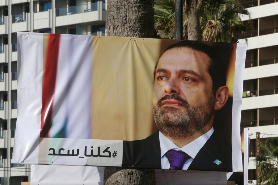 A poster depicting Lebanon's Prime Minister Saad al-Hariri, who has resigned from his post, is seen in Beirut, Lebanon, November 10, 2017. Reuters