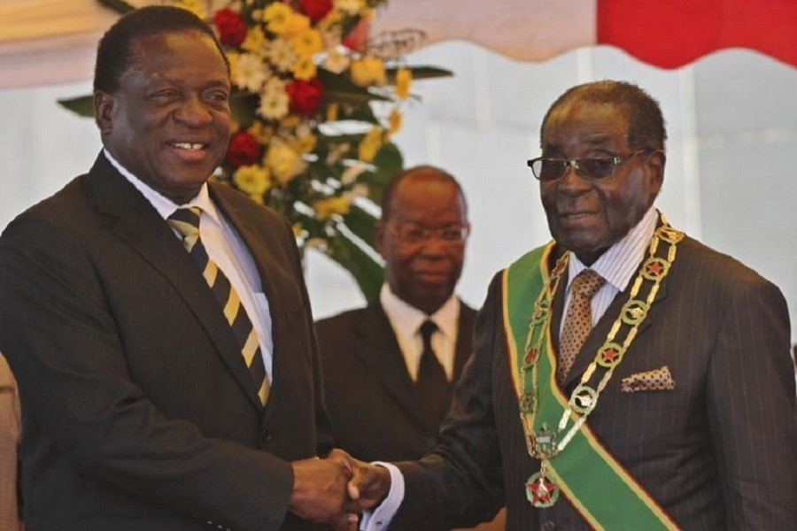 President Robert Mugabe (R) greets Vice President Emmerson Mnangagwa as he arrives for Zimbabwe's Heroes Day commemorations in Harare, August 10, 2015. Reuters
