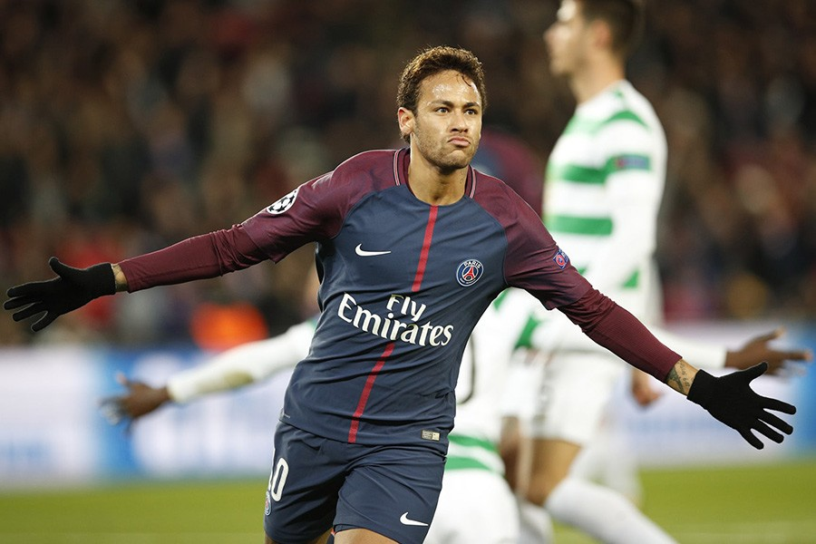 Neymar celebrates after scoring PSG's second goal in their Champions League drubbing of Celtic. - AP photo