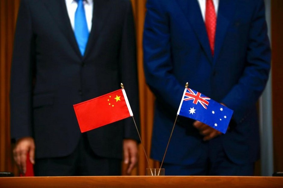 Australia's Prime Minister Malcolm Turnbull stands with Chinese Premier Li Keqiang before the start of an official signing ceremony at Parliament House in Canberra, Australia, March 24, 2017. Reuters/Files