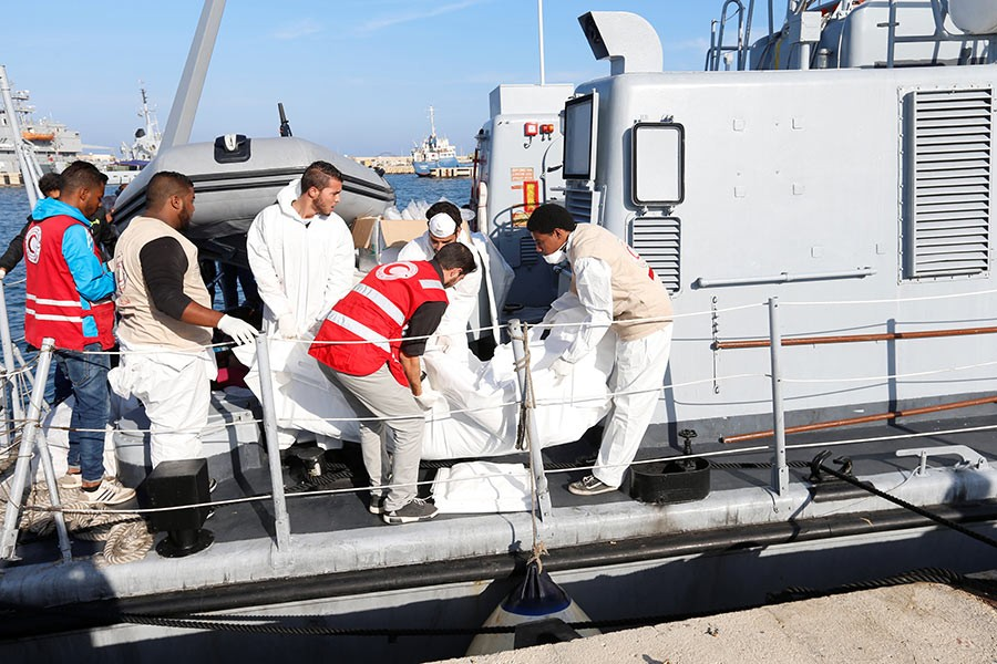 The dead, including a number of children, were brought back to Tripoli naval base where they were unloaded in white plastic body bags. - Reuters