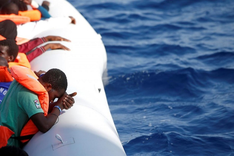 Migrants are seen during rescue operation in the Mediterranea Sea October 20, 2016. Italian Red Cross press office/Handout via Reuters