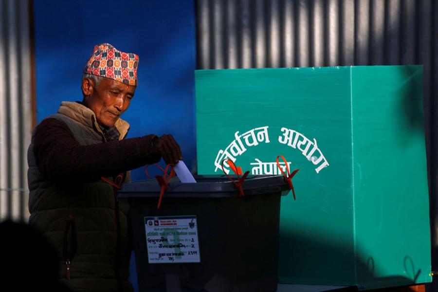 A man casts his vote in a ballot box during the parliamentary and provincial elections at Chautara in Sindhupalchok District on Sunday. - Reuters